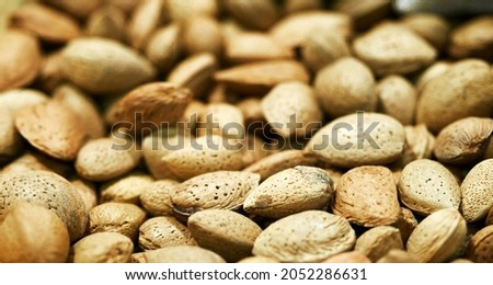 Tasty fresh almond nuts, background, texture. Selective focus. High quality photo Royalty-Free Stock Photo #2052286631