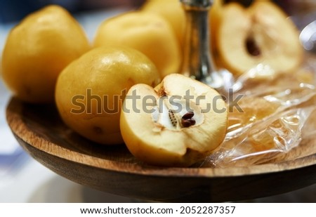 Tincture of quince and fruit on a wooden table. Selective focus. High quality photo Royalty-Free Stock Photo #2052287357