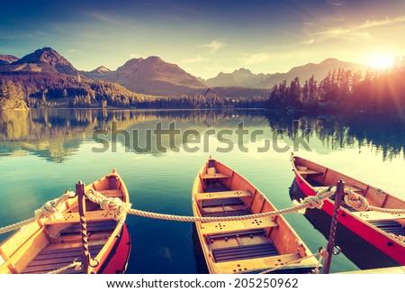 Fantastic mountain lake in National Park High Tatra. Dramatic scenery. Strbske pleso, Slovakia, Europe. Beauty world. Retro style filter. Instagram toning effect. Royalty-Free Stock Photo #205250962