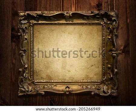 grunge wood background with golden vintage frame