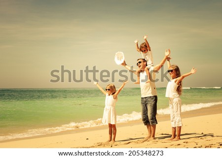 Happy family walking at the beach at the day time. Concept of friendly family. #205348273