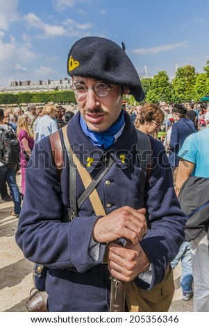 PARIS, FRANCE - JULY 14, 2014: Tuileries garden: People in historic World War I uniforms on French National Day (Bastille Day) in Paris commemorating 100th anniversary of the beginning of World War I. #205356346