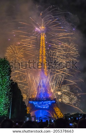 PARIS, FRANCE - JULY 14, 2014: Famous fireworks near Eiffel Tower during celebrations of French national holiday - Bastille Day. #205378663