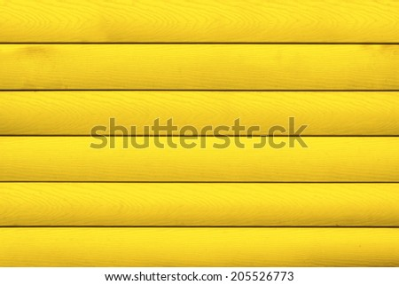Painted yellow wooden background or texture #205526773