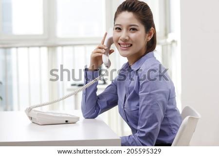 Businesswoman using a smart-phone