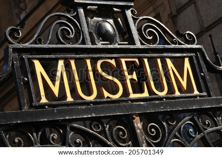 Museum sign on old metallic gate