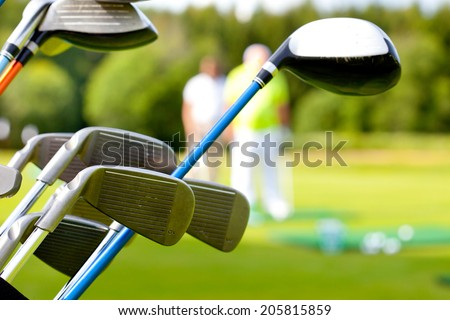 golf club against the background of green field