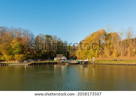 Several car ferries cross the Kiel Canal, here the Landwehr ferry in autumn Royalty-Free Stock Photo #2058173507