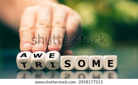 Symbol for a awesome life with trisomy. Dice forms the words awesome and trisome.  Royalty-Free Stock Photo #2058177215