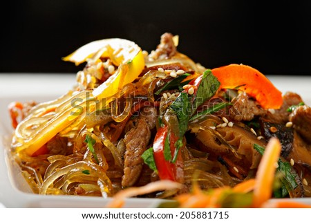 Glass rice noodles served with beef and vegetables closeup #205881715