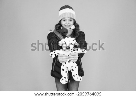 Childhood friend. Happy child hold toy blue background. Childhood fun. Care of childhood. Childcare. International childrens day. Winter season. Give every child happy childhood Royalty-Free Stock Photo #2059764095