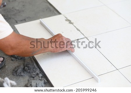 floor tile installation for house building  #205999246