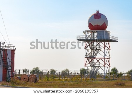 Aeronautical meteorological station tower with spherical radar at airport Royalty-Free Stock Photo #2060195957