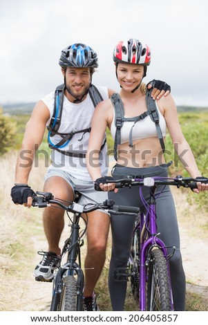 Fit couple cycling on mountain trail on a sunny day #206405857