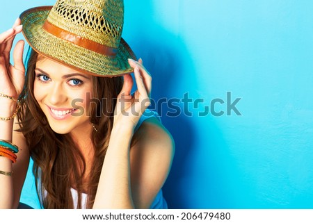 Smiling girl portrait. Girl hipster on blue background. Trilby yellow. Fashion portrait. #206479480