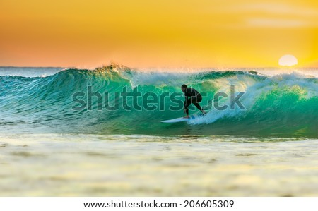 Sunrise Surfing Royalty-Free Stock Photo #206605309