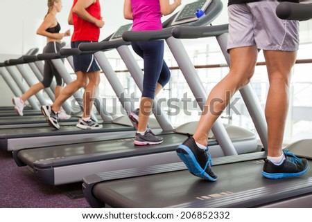 Row of people on treadmills at the gym #206852332