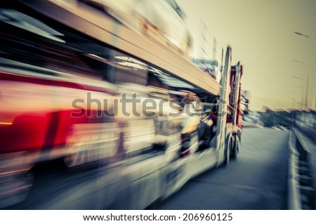 Truck transports cars, track in motion. #206960125