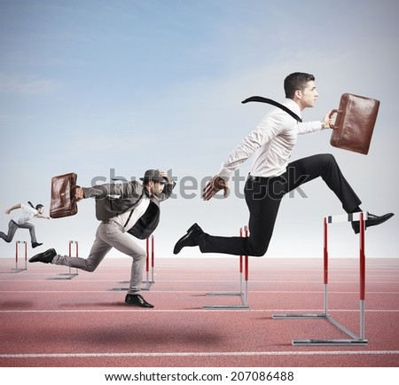 Business competition with jumping businessman over obstacle Royalty-Free Stock Photo #207086488