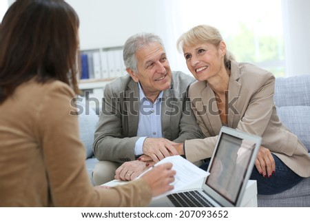 Senior couple meeting real estate agent #207093652