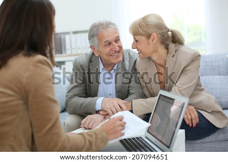 Senior couple meeting real estate agent #207094651