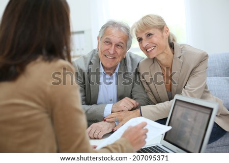 Senior couple meeting real estate agent #207095371