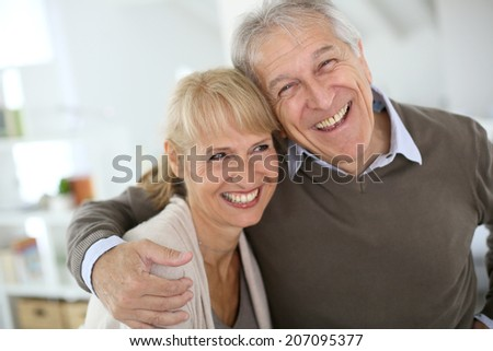 Cheerful senior couple embracing each other #207095377