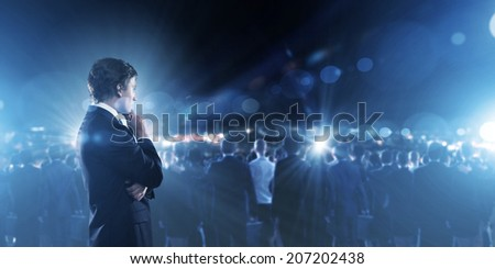 Businessman in suit against digital background with icons #207202438