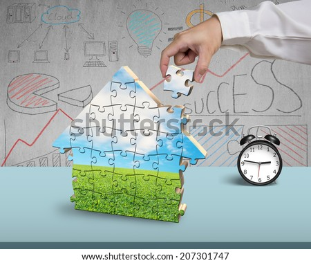 Finishing to assemble house shape puzzles in office #207301747