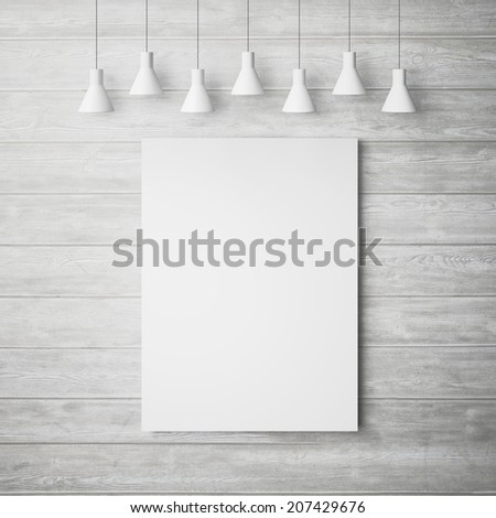 White poster on a wood wall with lamps