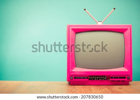 Retro old television from 80s front mint green wall background Royalty-Free Stock Photo #207830650