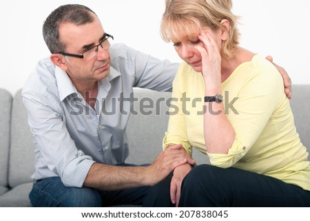 Man apologizing after an argument with his wife in the living-room #207838045