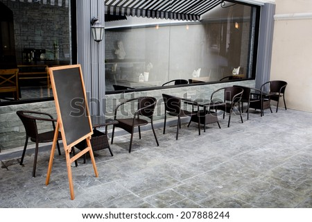 Concept and design front of Coffee Shop with black board and black seating #207888244