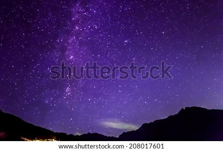 purple night sky stars and milky way over mountains #208017601