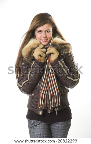 A smiling beautiful girl in winter clothes #20822299