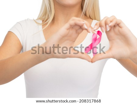 healthcare and medicine concept - young woman in blank white t-shirt with pink breast cancer awareness ribbon showing heart shape #208317868