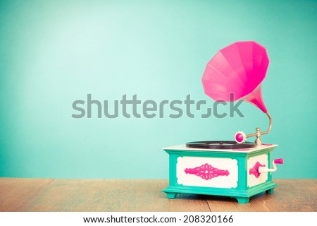 Retro old gramophone radio receiver front mint green background Royalty-Free Stock Photo #208320166