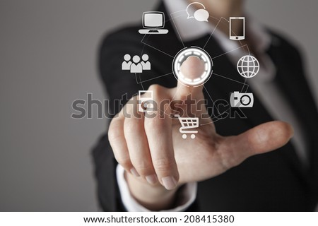 Businesswoman in front of visual touch screen. #208415380