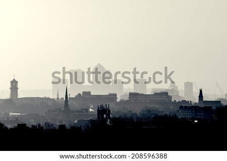 Gotham Retro Photo Filter - London Cityscape at Sunrise with early morning mist from Hampstead Heath looking towards Canary Wharf, England, UK