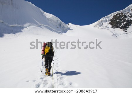 Climber walking up to the peak of mountain #208643917