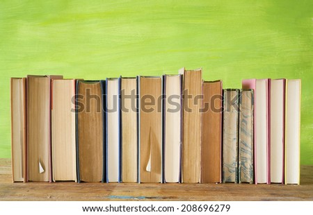 row of books, grungy background, free copy space  #208696279