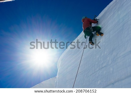 Low angle view of man climbing glacier #208706152