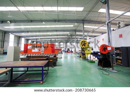 TANGSHAN CITY - MAY 28: Large machinery and equipment in a production workshop, on may 28, 2014, Tangshan city, Hebei Province, China  #208730665
