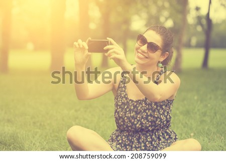 Vintage photo of woman taking a selfie with smart phone #208759099