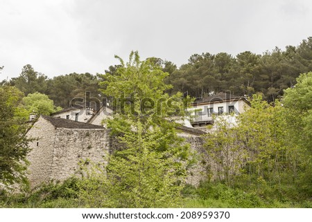 The old traditional stone houses in Metsovo Greek village, Greece, during a cloudy autumn day.  #208959370