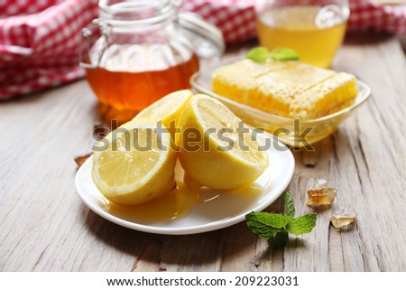 Lemon and honey on wooden table #209223031