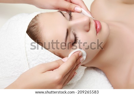 Young beautiful woman receiving facial massage and spa treatment #209265583