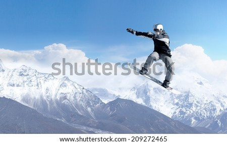 Snowboarder making high jump in clear blue sky #209272465