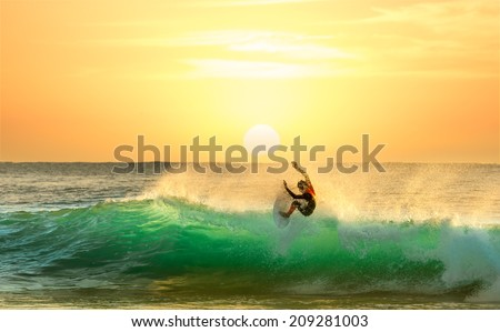 Surfing on a Green Wave with Sun Rising in the Background