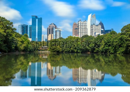 Skyline and reflections of midtown Atlanta, Georgia in Lake Meer from Piedmont Park.